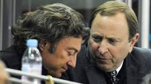 Edmonton Oilers' owner Daryl Katz, left, speaks with NHL commissioner Gary Bettman during an NHL game between the Edmonton Oilers and the Atlanta Thrashers in Edmonton on Saturday, Feb. 19, 2011.  (The Canadian Press)