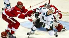 San Jose Sharks forward Logan Couture reacts to contact from Detroit Red Wings defenseman Danny DeKeyser (Tony Ding/AP)
