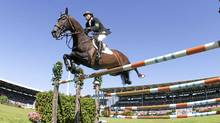 Eric Lamaze clears a jump on his horse Hickstead during the Grand Prix of Aachen tournament at the World Equestrian Festival on July 18, 2010. (Bernd Lauter/REUTERS/Bernd Lauter/REUTERS)