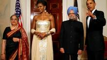 U.S. President Barack Obama and first lady Michelle Obama stand with India's Prime Minister Manmohan Singh and his wife Gursharan Kaur before a state dinner at the White House in Washington. (JASON REED/JASON REED/REUTERS)