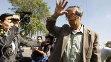 A man widely believed to be Bitcoin currency founder Satoshi Nakamoto is surrounded by reporters as he leaves his home in Temple City, California March 6, 2014. (DAVID MCNEW/REUTERS)