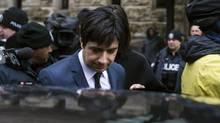 Jian Ghomeshi leaves court in Toronto on Thursday, March 24, 2016. (Christopher Katsarov/AP)