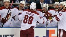 Arizona Coyotes left wing Mikkel Boedker (89) celebrates his goal against the Edmonton Oilers in the first period at Rexall Place on Oct 1, 2014. (Chris LaFrance/USA Today Sports)