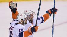 New York Islanders forward Andrew Ladd celebrates his goal during overtime with defenceman Calvin de Haan against the Vancouver Canucks at Rogers Arena. (Anne-Marie Sorvin/USA Today Sports)