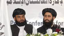 Muhammad Naeem (R), a spokesman for the Office of the Taliban of Afghanistan, speaks during the opening of the Taliban Afghanistan Political Office in Doha on June 18, 2013. The Afghan Taliban opened the office in Qatar to help restart talks on ending the 12-year-old war, saying it wanted a political solution that would bring about a just government and end foreign occupation. (MOHAMMED DABBOUS/REUTERS)