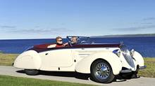 1938 Steyr 220 Roadster owned by Peter Boyle; the couple in car are restorer Roger James and his wife. (Lucas Scarfone/Cobble Beach)