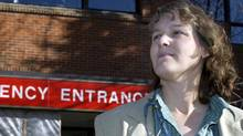 Deputy regional health officer, Dr. Judy MacDonald, waits in front of the Alberta Children's Hospital in Calgary, Friday, Nov. 14, 2003, for a news conference to begin. The Calgary Regional Health Authority made plea to the public to not over use the emergency room's in it's hospitals. (Jeff McIntosh/The Globe and Mail)