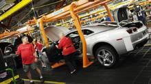 Workers on General Motors 'flex line' build automobiles in Oshawa, Ont., in this photo from June, 2011. (Kevin Van Paassen/Kevin Van Paassen/The Globe and Mail)