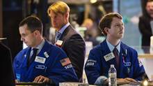 Traders work on the floor of the New York Stock Exchange May 8, 2013. (LUCAS JACKSON/REUTERS)