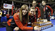 Ontario skip (L-R) Rachel Homan, third Emma Miskew, second Alison Kreviazuk, lead Lisa Weagle pose with the trophy after defeating Manitoba to win their gold medal game at the Scotties Tournament of Hearts curling championship in Kingston, February 24, 2013. (Mark Blinch/REUTERS)