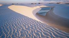 The best time to visit the dunes of Lencois Maranhenses National Park in Brazil is May through September, when the rains have stopped and the lagoons are at their fullest. (Alamy)