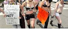 "From left: Isa Stearns of Somerville, Mass., Nadia Friedler of Cambridge, Mass., Louisa Carpenter-Winch, of Cambridge, Mass., and Emma Munson-Blatt, of Cambridge, Mass, march in the ""SlutWalk"" in Boston on Saturday, May 7, 2011. (JOSH REYNOLDS/AP/JOSH REYNOLDS/AP)"