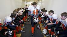 Warriors football players prepare for their game their game against the Sexsmith Sabres on Oct. 29, 2011. (Jason Franson/The Globe and Mail/Jason Franson/The Globe and Mail)