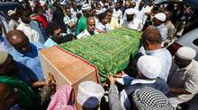 The casket holding the remains of slain Toronto teacher and graduate student Abshir Hassan is carried out of a mosque after his funeral in Toronto on Friday. (Mark Blinch For The Globe and Mail)