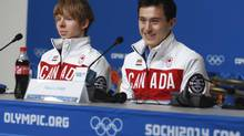 Figure skaters Patrick Chan (right) and Kevin Reynolds at a press conference at the Main Press Centre for the Sochi Winter Olympics in Sochi, Russia, Tuesday, Feb. 4, 2014. (Mike Ridewood/THE CANADIAN PRESS)