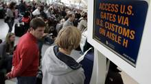 Passengers wait in line at U.S. Customs to board their flights at Toronto's Pearson International Airport on Dec. 27, 2009. (J.P. MOCZULSKI FOR THE GLOBE AND MAIL)
