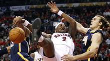 Toronto Raptors James Johnson battles for the ball with Indiana Pacers Danny Granger, left, and Lou Amundson during the first half of their NBA basketball game in Toronto December 28, 2011. (MARK BLINCH/REUTERS)