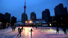 Skaters make their way around the Natrel Rink at the Harbourfront Centre along Toronto's waterfront. (Tim Fraser for The Globe and Mail)