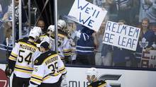 Boston Bruins players leave the ice as Toronto Maple Leafs fans cheer (Nathan Denette/THE CANADIAN PRESS)
