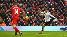 Manchester United's Wayne Rooney took his tally for 2016 to five goals in four games by smashing home a volley from close range in the 78th minute after Marouane Fellaini's header rebounded off the bar on Jan. 17 in Liverpool. (Alex Livesey/Getty Images)