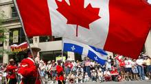 A Canada Day parade in Montreal in 2003 on the country's 136th birthday. (PAUL CHIASSON/Canadian Press)