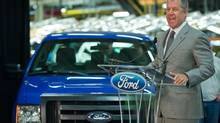 Joe Hinrichs, Ford Motor Co.'s president of the Americas, announces Thursday, May 2, 2013 that the company is adding 2,000 workers to the Claycomo, Mo. plant, where the the F-150 pickup is made, because of surging U.S. truck demand. (David Eulitt/The Associated Press)