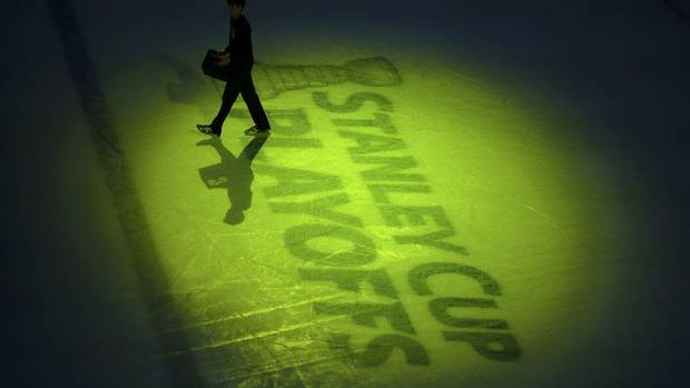A rink employee carries pucks from the ice before Game 7 of the NHL Eastern Conference quarter-final hockey playoff series between the Bostonn Bruins and the Toronto Maple Leafs in Boston, Massachusetts May 13, 2013. (BRIAN SNYDER/REUTERS)