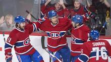 Montreal Canadiens' Rene Bourque, second from left, celebrates his goal with teammates David Desharnais,51, Daniel Briere, 48, and P.K. Subban during first period NHL action in Montreal Thursday, October 17, 2013. (PETER MCCABE/THE CANADIAN PRESS)