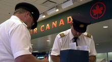 Air Canada pilots fill out custom forms prior to flying out of Terminal Two at Pearson Airport. July.15.2003 photo by Fred Lum/The Globe and Mail DIGITAL IMAGE (Fred Lum/The Globe and Mail)