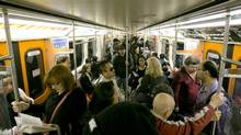 Commuters ride a TTC subway west from Kennedy Station in Scarborough, Ontario Wednesday, September 25, 2013. (Kevin Van Paassen/The Globe and Mail)