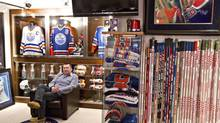 Shawn Chaulk poses with his collection of Wayne Gretzky memorabilia in Fort McMurray, Alta. (JASON FRANSON/THE CANADIAN PRESS)