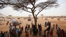 Newly arrived Somali refugees queue for tents being distributed on the edge of the Dagahaley refugee camp in Kenya on July 21, 2011. More than 11 million people in the Horn of Africa require food assistance due to the drought. (Oli Scarff/Getty Images)