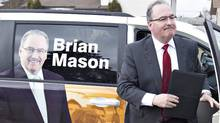 NDP Leader Brian Mason makes his way to a residential home to make his platform announcement in Edmonton March 28, 2012, for the upcoming Alberta provincial election. (Jason Franson/The Canadian Press/Jason Franson/The Canadian Press)