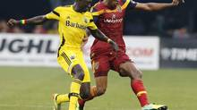 Columbus Crew forward/midfielder Dominic Oduro battles with Real Salt Lake defender Chris Schuler for the ball (Barbara J. Perenic/AP)