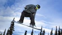 Snowboarder Dakotah Newman, 16, flies off a jump at Whistler February 10, 2011. (John Lehmann/The Globe and Mail)/John Lehmann/The Globe and Mail)