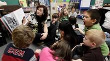 Teacher Jaime Fernie reads an Aboriginal-themed book to her all-day kindergarten and grade 1 class at Mission Central Elementary School in Mission, B.C., on Thursday December 16, 2010. (DARRYL DYCK/Darryl Dyck / The Canadian Press)