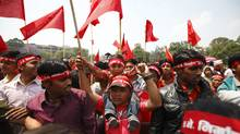 Maoist activists and supporters wave Maoist flags as they arrive during a rally to commemorate Labour Day in Kathmandu May 1, 2012. (NAVESH CHITRAKAR/NAVESH CHITRAKAR/REUTERS)
