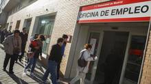 People enter a government-run employment office in Madrid April 29, 2014. (ANDREA COMAS/REUTERS)