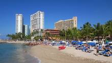 The beaches of Puerto Vallarta, Mexico, are within reach for the frugal traveller who flies out in the middle of the week. (David Stanley)