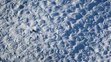 A skier makes his way down a run on Whistler Mountain in British Columbia. (The Globe and Mail)