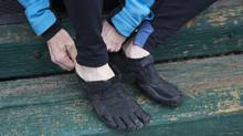 Dr. Richard Ehrlich puts on his Vibram FiveFingers running shoes in Caledon, Ontario, on Tuesday, December 23, 2014. (Matthew Sherwood for The Globe and Mail)