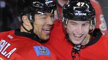 Calgary Flames' Jarome Iginla (L) and teammate Sven Baertschi celebrate Baertschi's goal during the second period of their NHL hockey game against the San Jose Sharks in Calgary, Alberta March 13, 2012. REUTERS/Todd Korol (Todd Korol/Reuters)