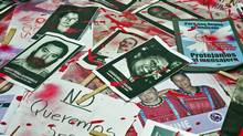 Mexican journalists protest against violence towards journalists in Mexico placing on the ground pictures of murdered journalists, on August 7, 2010 in Mexico City. More than 60 journalists have been killed in Mexico during the last decade, many of them by drug traffickers. (Ronaldo Schemidt/AFP/Getty Images)