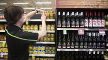 Fermented grape drinks sit next to canned fruit at a Save-On-Foods in Surrey, one of only four B.C. supermarkets selling wine. (Ben Nelms For The Globe and Mail)