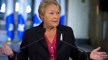 Quebec Premier Pauline Marois responds to reporters' questions at a news conference December 6, 2012, at the legislature in Quebec City. (Jacques Boissinot/THE CANADIAN PRESS)