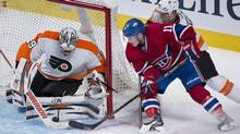 Montreal Canadiens' Brendan Gallagher, centre, moves in on Philadelphia Flyers' goaltender Ray Emery, left, as Flyers' Kimmo Timonen defends during second period NHL action in Montreal, Saturday, October 5, 2013. (Graham Hughes/THE CANADIAN PRESS)
