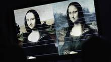 """Horizontal comparison lines between a painting attributed to Leonardo da Vinci and representing Mona Lisa (L) and the """"Joconde"""" painting are pictured on a TV screen during a presentation in Geneva September 27, 2012. The Mona Lisa Foundation, a non-profit organisation, presented today historical, comparative and scientific evidence, which demonstrate that there have always been two portraits of the Mona Lisa by Leonardo da Vinci, the """"Earlier Version"""", made 10 years earlier than the """"Joconde"""" that is displayed in Le Louvre in Paris. (Reuters)"""