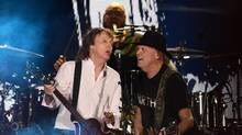 Sir Paul McCartney (L) and Neil Young perform onstage during Desert Trip at the Empire Polo Field on October 8, 2016 in Indio, California. (Kevin Winter/Getty Images)