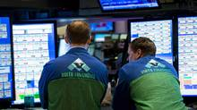 Traders work at a Virtu Financial booth at the New York Stock Exchange in 2015. (Brendan McDermid/REUTERS)