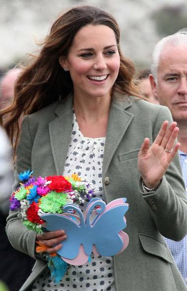Britain's Catherine, Duchess of Cambridge visits the Breakwater country park, to start the Ring O Fire ultra marathon, in Anglesey, north Wales August 30, 2013. (Paul Lewis/AP)